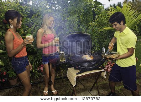 three friends at a barbecue