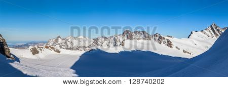 Panorama view of swiss Alps of Bernese Oberland and Valais from Monchsjoch Mountain Hut on a winter sunny day Switzerland