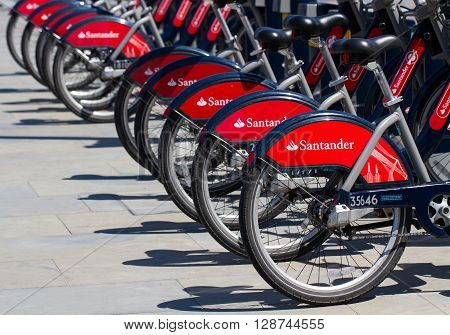 LONDON, UK - MAY 5, 2016. A row of Santander Bank sponsored bicycles from London's popular bike hire scheme. The bikes are also known as Boris Bikes after The Mayor Of London, Boris Johnson who introduced the scheme.