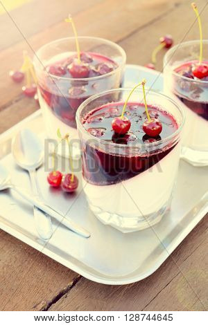 Traditional Italian dessert pinna cotta in the glasses.Selective focus on the front glass..