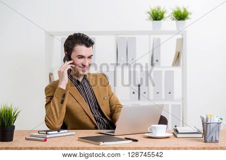 Businessman On Phone In Office