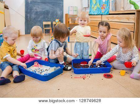 Children improving motor skills of hands in kindergarten