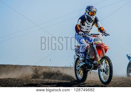 Miasskoe Russia - May 02 2016: racer motorcyclist riding on track under wheels of dirt during Cup of Urals motocross