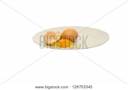 Broken egg isolated on a white plate