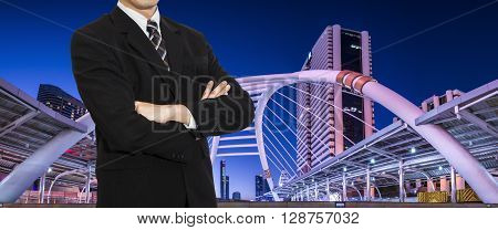One smart business man wear black suit stand on modern building in night light Panorama background