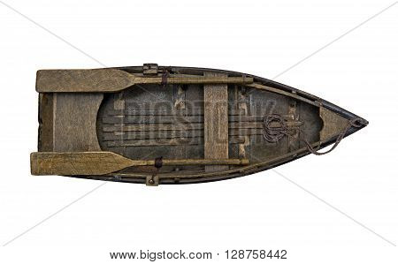 Isolated wooden boat with paddles over white