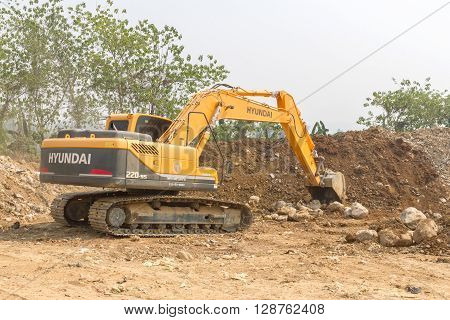PAI THAILAND 10 April 2016 : A big excavator earthmoving works on new construction site in Pai, Thailand