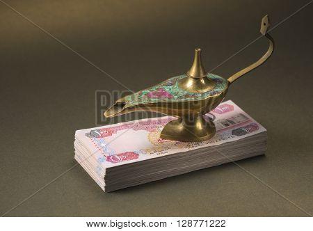 'Dream come true' - an idea. Alladdin lamp and hard cash - a metaphor.