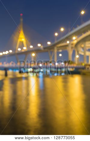 Blurred bokeh lights night view, Rama suspension bridge at twilight