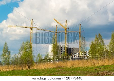 Construction of multistorey apartment houses in the natural landscape