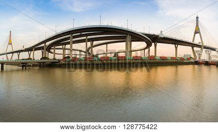 Panorama Twin Suspension bridge connect to highway interchange in Bangkok Thailand during sunset