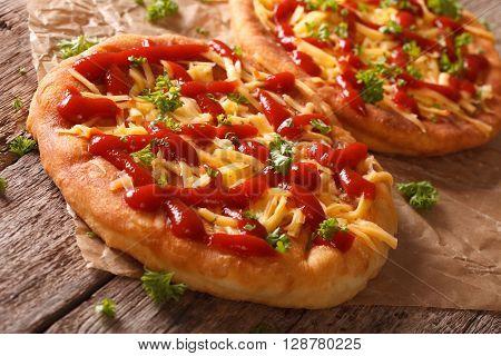 Tasty Langos With Cheese And Ketchup Close-up. Horizontal