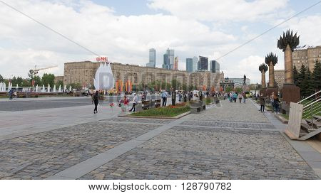 Moscow - May 6 2016: A lot of people walk in Victory Park on Kutuzovsky Prospekt on Poklonnaya Hill May 6 2016 Moscow Russia