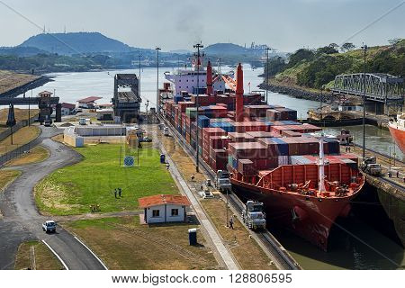 Panama Canal Panama - March 3 2014: A cargo ship entering the Miraflores Locks in the Panama Canal in Panama