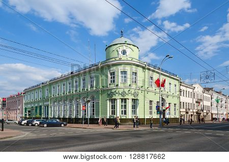 GOMEL BELARUS - May 1 2016: Unidentified people go near branch of National Bank of Republic of Belarus (former Russian-Asian Bank) on corner of Streets Sovetskaya and Lange Gomel Belarus