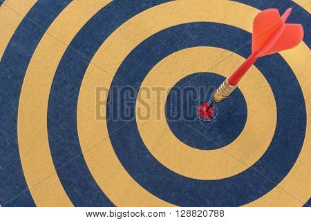 Dart target with arrow on bullseye Goal target success business investment financial strategy concept abstract background