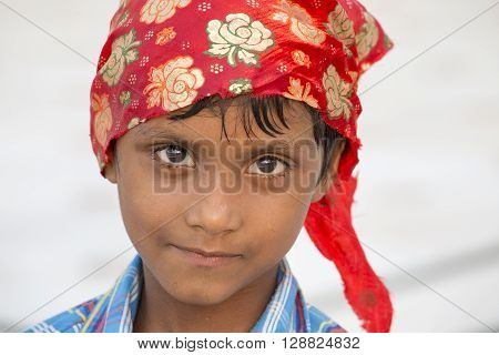 AMRITSAR INDIA - SEPTEMBER 26 2014: Unidentified young Sikh boy visiting the Golden Temple in Amritsar Punjab India. Sikh pilgrims travel from all over India to pray at this holy site.