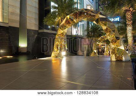 BANGKOK THAILAND - JANUARY 23 2015: Siam Paragon shopping center at night Bangkok Thailand. Siam Paragon is one of the largest malls in the world.