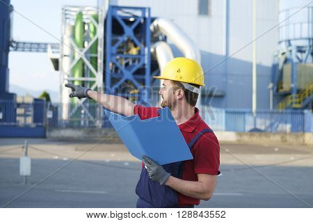 worker check control outside a modern factory