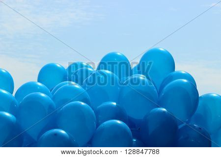 many blue balloons on the sky background