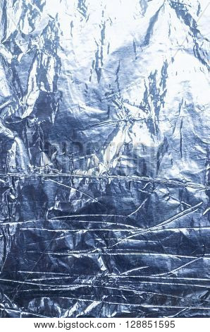 An abstract blue foil texture or background