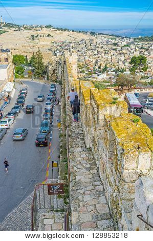 JERUSALEM ISRAEL - FEBRUARY 18 2016: The rampart walk in the neighborhood of Zion Gate with the view on the Mount of Olives on February 18 in Jerusalem.