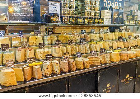 JERUSALEM ISRAEL - FEBRUARY 17 2016: The various types of halva the famous Eastern dessert in Mahane Yehuda market on February 17 in Jerusalem.