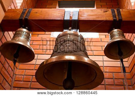 Religious Christian bells. Brick bell tower. The ringing of the bell.