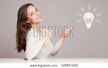 Young Woman Next To Creativity Symbol.