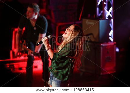 PATCHOGUE, NY-MAR 9: Singer Jessie James Decker performs onstage at the Emporium on March 9, 2016 in Patchogue, New York.