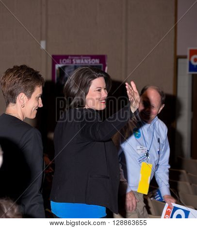 SHAKOPEE, MINNESOTA - APRIL 30, 2016: Congressional candidate Angie Craig of Minnesota waves to supporters after her endorsement at local democratic party convention in Shakopee on April 30.