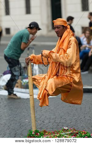 Rome Italy - June 12 2015: Indian Fakirs Performing Levitation Trick In Rome Italy