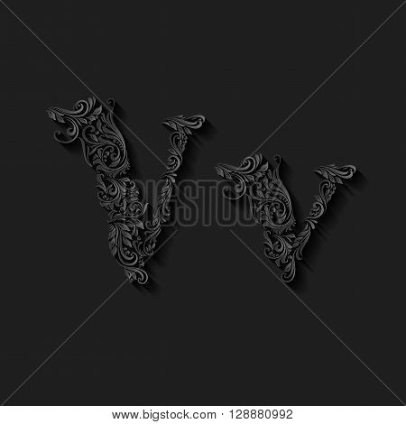 Handsomely decorated letter v in upper and lower case on black
