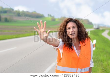 Frantic Young Woman Trying To Stop Traffic