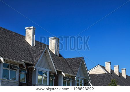 Modern residential building against blue sky in North America.