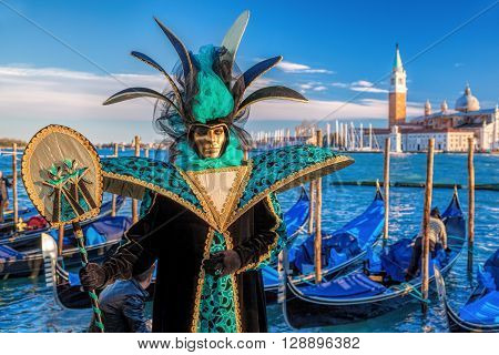 VENICE, ITALY-FEBRUARY 04:People posing wearing a typical Carnival mask in St. Mark's Square. The Carnival of Venice is a annual festival held in Venice.
