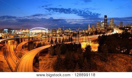 Seattle city view with urban architecture and traffic light trail.