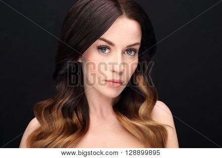The beauty of a woman. Long eyelashes, mesmerizing look.
