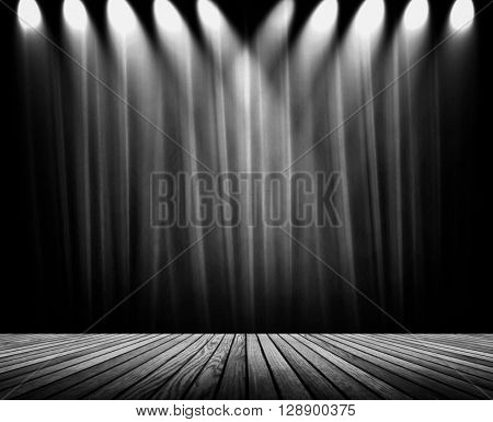 black curtain with wood plank stage