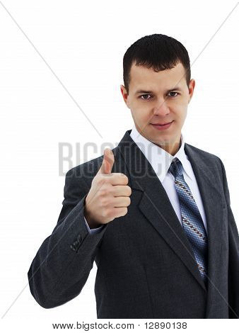 Successful young businessman with thumb up - isolated