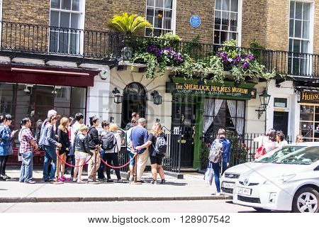 LONDON UK - JUNE 6 2015 - Facade of the Sherlock Holmes house and museum in 221b Baker Street. Here is where Arthur Conan Doyle located the studio of the famous detective.
