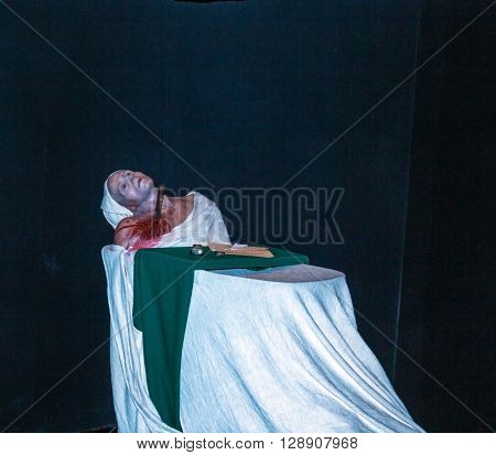 LONDON UK - JUNE 7 2015: Death of Marat at one of halls of historical part of Madame Tussauds wax museum. Madame Tussauds London is famous for recreating famous people and celebrities in wax.