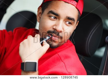 Young Black Boy Smoking E-cig Vaporizer In Car