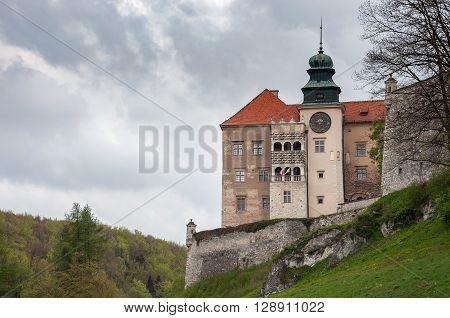 Pieskowa Skala Poland - May 1 2011: View of renaissance castle in Pieskowa Skala on a cloudy day.