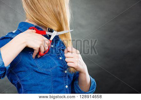 Blonde Woman Cutting Her Hair.