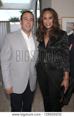 PALM SPRINGS - APR 27: Louie Anchondo, Beverly Johnson at a cultivation event for The Actors Fund at a private residence on April 27, 2016 in Palm Springs, California