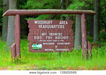 WOODRUFF, USA - JUNE 14: The Art Oehmcke State Fish Hatchery on June 14, 2015 in Woodruff, Wisconsin. It opened in the year 1901.