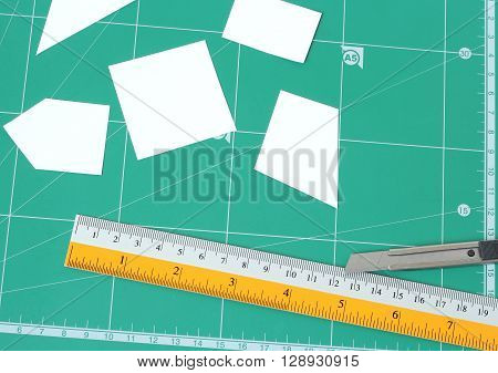 Paper And Green Cutting Mat