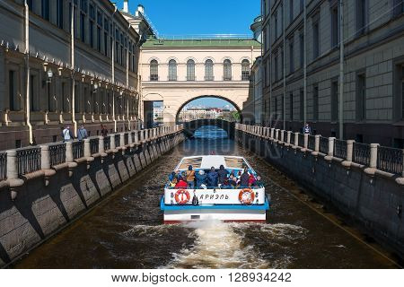 St. Petersburg Russia - May 8 2016: Tourist boat moves along the Winter Canal near the Hermitage. It is a popular trip in the city