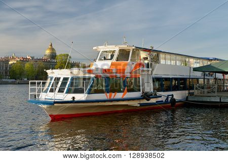 Russia.08.05.2016.In St.-Petersburg has begun the tourist season.Boats and ships with tourists go along the rivers and canals of the city.